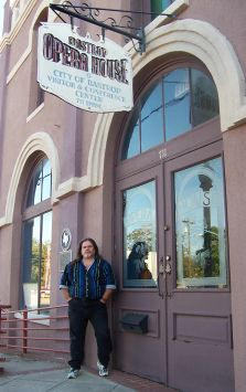 john in front of the historic Bastrop Opera House